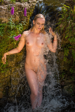 young nude woman: Beautiful young nude woman enjoying summertime in the waterfall
