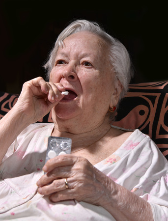 heartattack: Old sick woman with pills at home