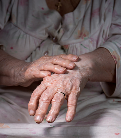 womans hands: Close up of old wrinkled womans hands Stock Photo