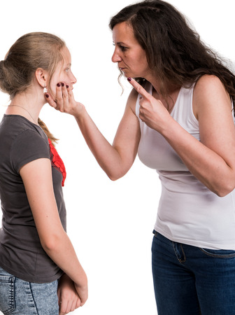 Family problems. Mother shouting at her teenage daughter on a white background
