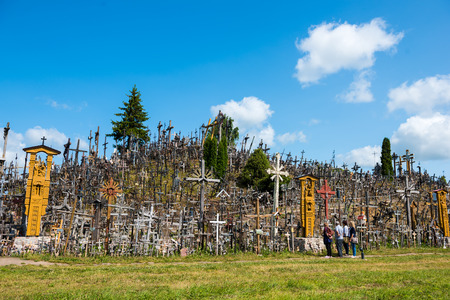 SIAULIAI, LITHUANIA - JUL 12, 2015: The Hill of Crosses (Kryziu kalnas) in Siauliai, Lithuania, Europe. One of the most important pilgrimage sights of the Baltic. Редакционное