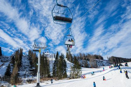HIGH TATRAS, STRBSKE PLESO,SLOVAKIA - JANUARY 03, 2016: Winter mountains panorama with ski slopes and ski lifts