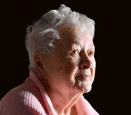 saddened: Portrait of old  sick sad woman at home