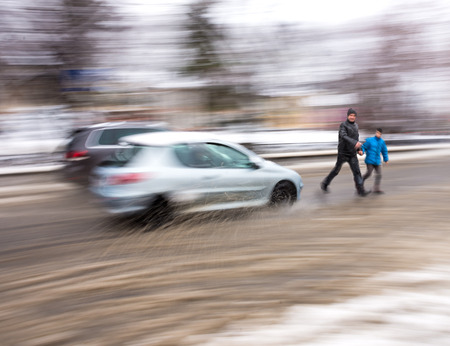 Dangerous situation on city roads in winter time.  Intentional motion blur Stock Photo