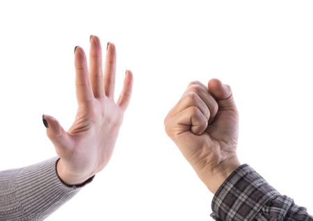 veto: Woman making stop gesture, man showing fist on a white background. Stop the violence Stock Photo