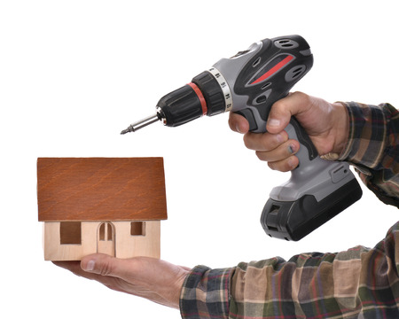 Man holding  wrench and house on a white background