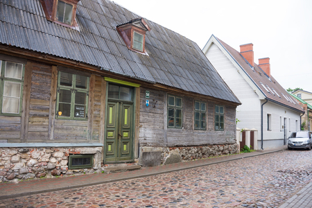 LIEPAJA, LATVIA - JULY 25, 2016: View of the street with wooden  old building in Liepaja, Latvia.Typical  old residential wooden house