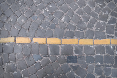 Yellow  intermittent  line. Road markings on paving on the street  Stockfoto