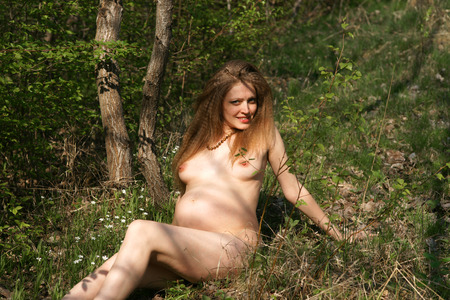 Romantic image of young naked pregnant woman posing outdoors. Enjoying summer time in hot day Stock Photo