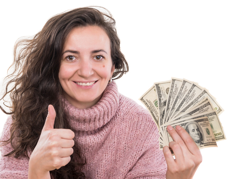 Christmas, sale, banking concept. Woman posing  with us dollar money on a white background