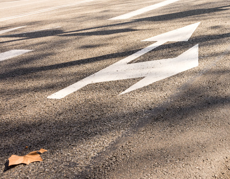 Direction on road. Arrow symbolsign on a road surface Stockfoto