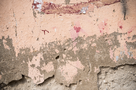 Remnants of old paint on the concrete wall