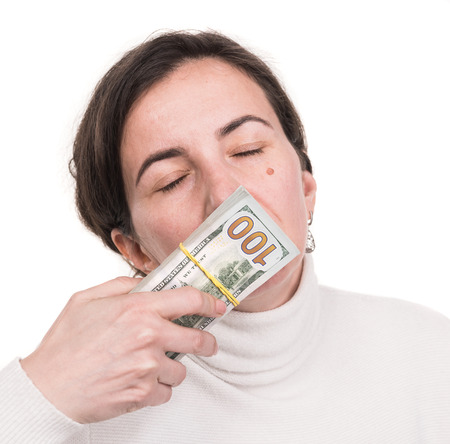 Money, finances, investment and saving concept. Brunette woman with dollar cash money over white background