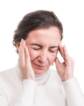 Healthcare, stress and headache concept. Stressedl woman touching temples over white background. Brunette having headache Stock Photo