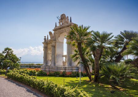 NAPLES, ITALY - MAY 2, 2019: Fontana del Gigante in the central part of Naples. It was designed in the 17th century by Michelangelo Naccherino and Pietro Bernini for the Royal Palace of Naple