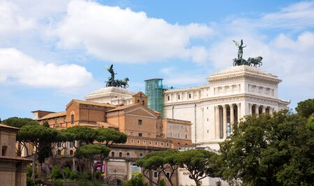 ROME, ITALY - MAY 3, 2019:  The Altare della Patria in Piazza Venezia, a war memorial monument with statues and ancient columns. Also known as the National Monument to Victor Emmanuel II