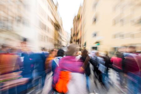 Busy city street people on zebra crossing. Intentional motion blur. Defocused image