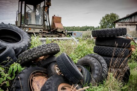 Close-up of broken  damaged tires. A bunch of old used tires.  Dump tires. Stacked old tires