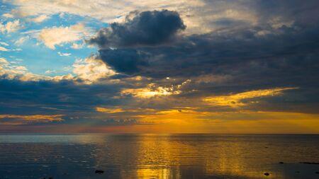 Amazing sunset over the beach on Baltic sea. Seascape Stock Photo