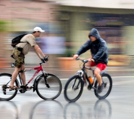 Dangerous bicycle traffic situation on the road. Intentional motion blur. Defocused image