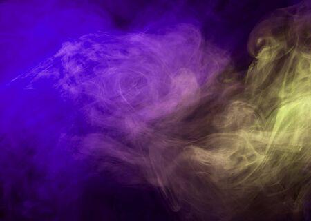 Abstract smoke on a dark background. Movement of color smoke. Smoke texture