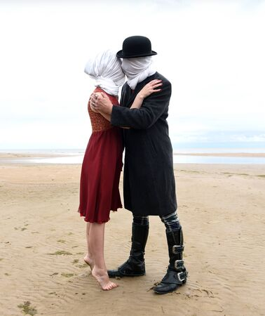 Kissing couple with completely closed heads posing at the beach Stok Fotoğraf