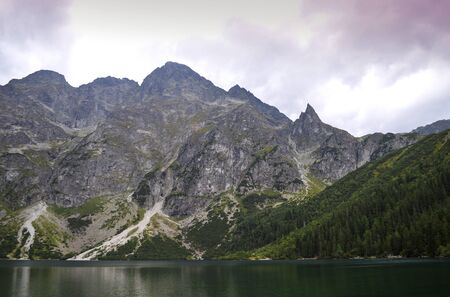 Morskie Oko (Sea Eye) Lake in the  mountains. Lake is the most popular place in High Tatra Mountains, Poland. Foto de archivo - 130806356