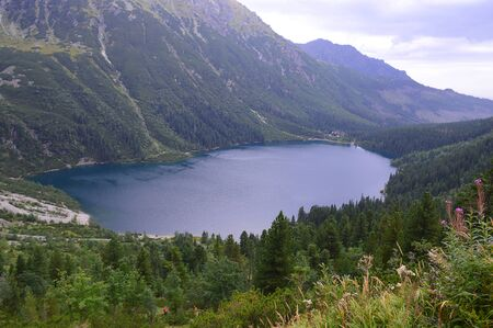 Morskie Oko (Sea Eye) Lake in the  mountains. Lake is the most popular place in High Tatra Mountains, Poland. Фото со стока