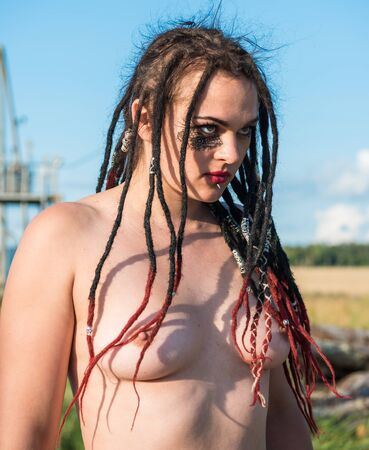 Beautiful naked young woman. Young naked woman with dreadlocks. Sexy nude  enjoying summertime outdoors