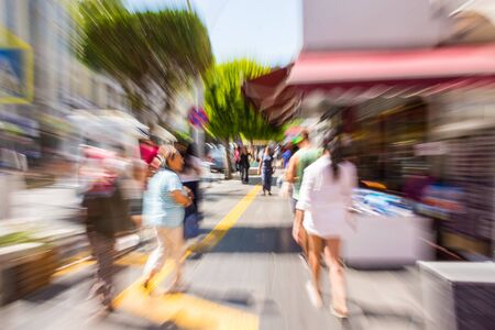 Busy city people going along the street. Intentional motion blur. Defocused image Stock fotó