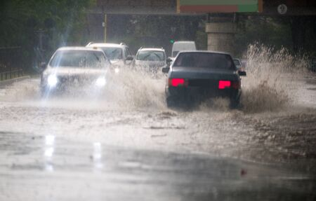 Strong rain in the city. Street of the city flooded after heavy rains