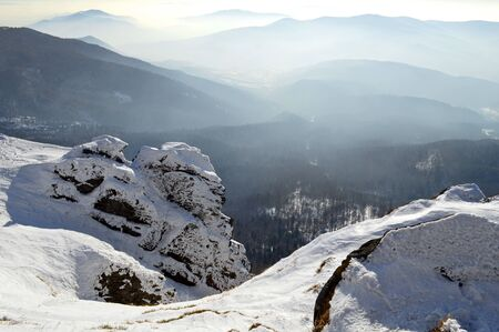 Winter Carpathian mountains on a bright sunny day. Winter snow covered mountain peaks Stock fotó