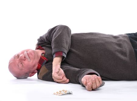 Healthcare and medicine concept. Senior man falling down from stroke or heart attack. Sick male couldn't get and take the medicine Banque d'images