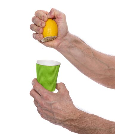 Raising immunity and healthcare concept. Male squeezing half of lemon to a glass on white background Archivio Fotografico