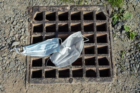 Environmental pollution concept. Used protective masks on the ground Reklamní fotografie