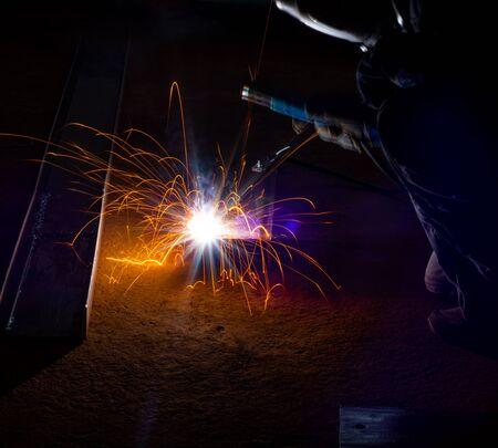 Metal welding. Arc welding of a steel in construction site