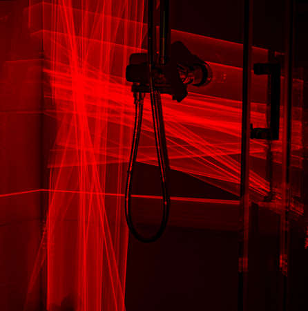 Shower cabin in red laser light
