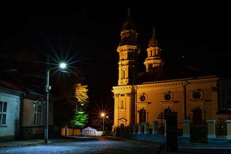 Greek Catholic Cathedral in Uzhgorod, Ukraine at night. Krestovozdvizhensky Cathedral is a landmark of the city of Uzhhorod. Built in 1646
