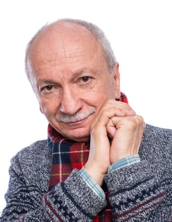 Positive smiling senior man posing in studio over white background