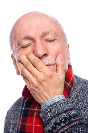 Health care concept. Senior man suffering from headache over white background