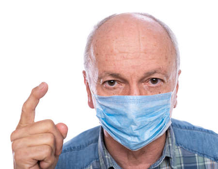 Health care concept. Senior man in protective mask  posing in studio over white background