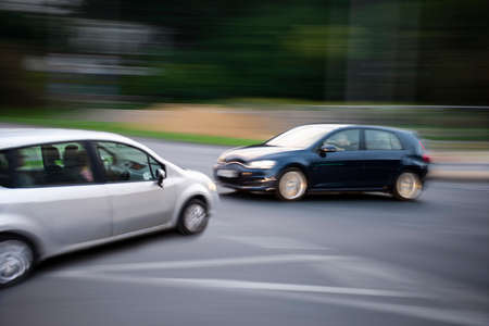 Car accident. Two cars crashed on the city road. Intentional motion blur. Defocused image