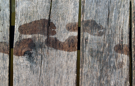 wooden boards with traces of bare child feet