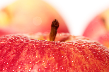 fresh red apple with water drops