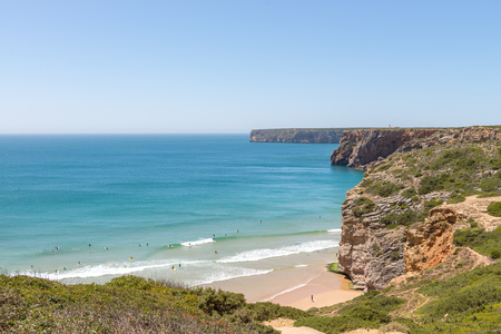 region of algarve: Beliche beach in the Algarve region of Portugal. A view of people surfing from the top.