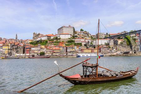 PORTO, PORTUGAL, APRIL 27, 2014: City of Porto seen from Vila Nova de Gaia with the traditional boats with wine barrels - Porto, Portugal