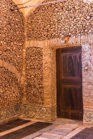 transient: EVORA, PORTUGAL -APRIL 30, 2014: Chapel of the Bones in Evora with human bones and skulls in the wall - Alentejo, Portugal