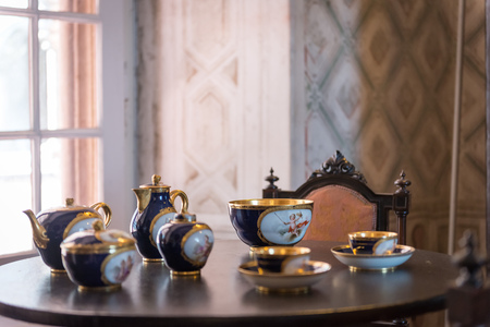 pena: Sintra, Portugal - March 25, 2013: Tea set inside Pena Palace in Sintra, Portugal. UNESCO World Heritage Site and one of the Seven Wonders of Portugal Editorial