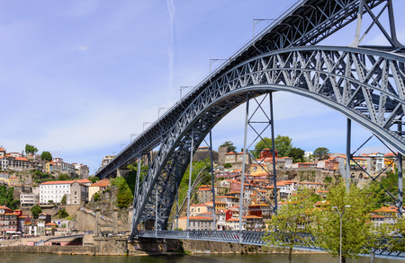 luis: View of Porto with the famous bridge Dom Louis over the river Douro. This bridge was  designed by the famous architect Eiffel. Porto, Portugal