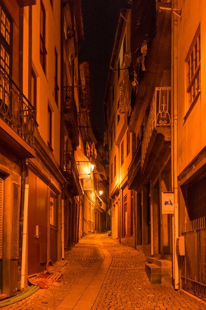 View of facades, alleyway and traditional houses in Ribeira old and historic town and alongside Douro River, Porto, Portugal